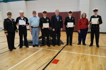 Wolverine Division of the Naval Sea Cadet Corps (NSCC) award ceremony in Monroe. Commanding Officer, LCDR Lisa Stoyanovich, with representatives of the American Legion, SAR and DAR and the recipients of their medals of those organizations.