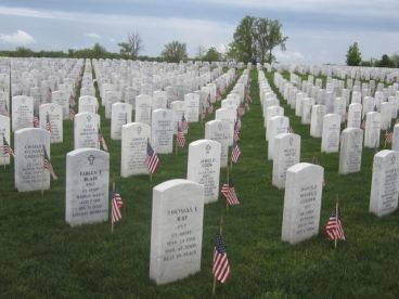 Headstones at Great Lakes National Cemetery with flags out for Memorial Day