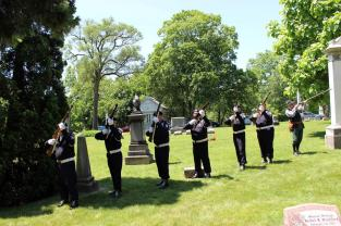 American Legion Livonia Post 32 Honor Guard firing volley Photo by Chris White