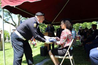 American Legion Post 32 member presents the flag to U of D Mercy School of Law BLSA President Cheryl Mitchell. Photo by Chris White