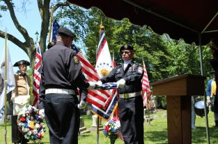 American Legion Livonia Post 32 folds the American flag. Photo by Chris White