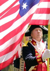 Member of MISSAR Color Guard with an early six pointed American flag. Photo by Chris White