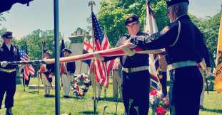 The Livonia American Legion Honor Guard folding the American flag on june 22 2019