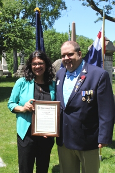 Congresswoman Rashida Tlaib with me presenting an official copy of her account of Robinson she submitted into the Congressional Record. Photo by Chris White.