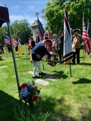 President James Petres places a wreath at Robinson grave after speaking