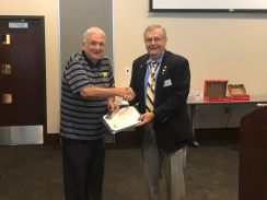 Registrar Al Treppa receives the MISSAR Century Club Certificate and the Bronze Medal from President Petres.