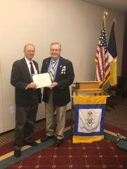 New Member John Luke is presented his membership Certificate by President Petres.