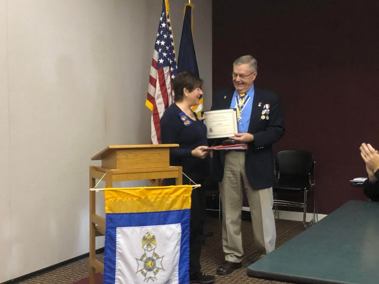 Sue Petres is presented a Certificate of Appreciation for her program of tombstone images by the chapter President.