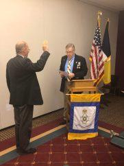 New Member Jon Luker is sworn in as a member by President Petres.